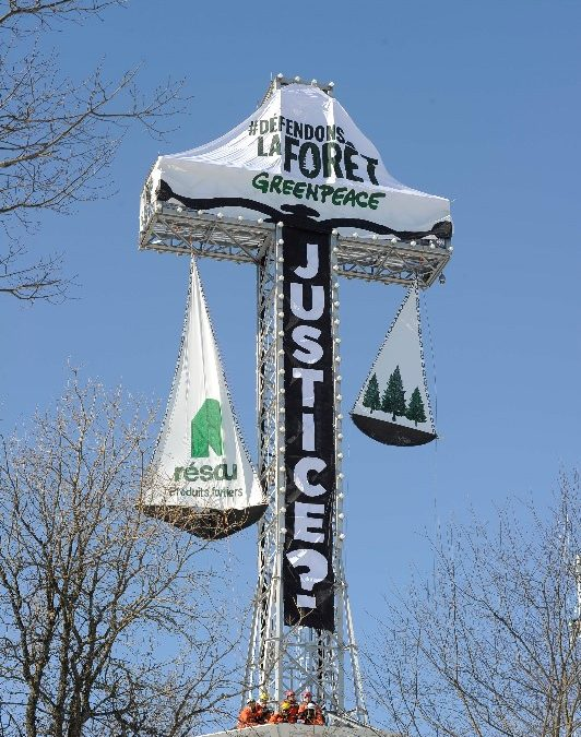 RELEASE: Mount Royal Cross transformed into scales of justice: Greenpeace protests the reckless destruction of Canada's Boreal Forest